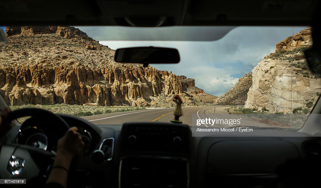 Woman Driving Car On Country Road : Stockfoto