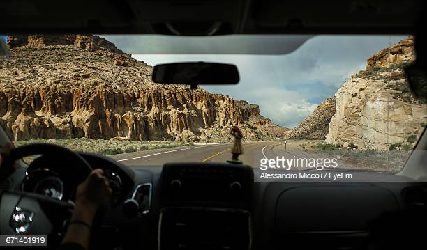 woman driving car on country road - alessandro miccoli stockfoto's en -beelden