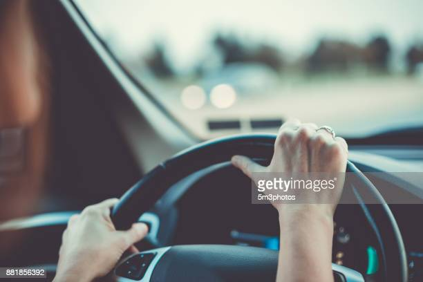 woman driving car or suv - steering wheel stock pictures, royalty-free photos & images