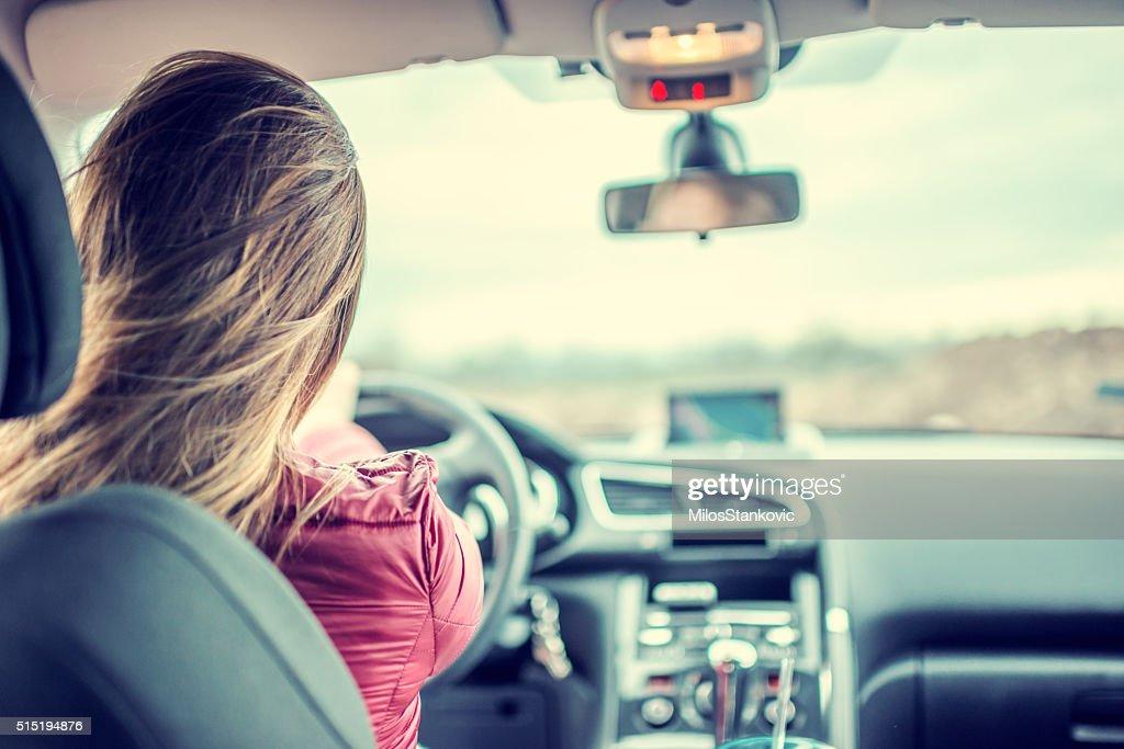 Woman driving car : Stock Photo
