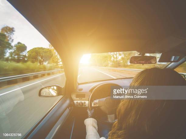 woman driving her car - hybrid car stock pictures, royalty-free photos & images