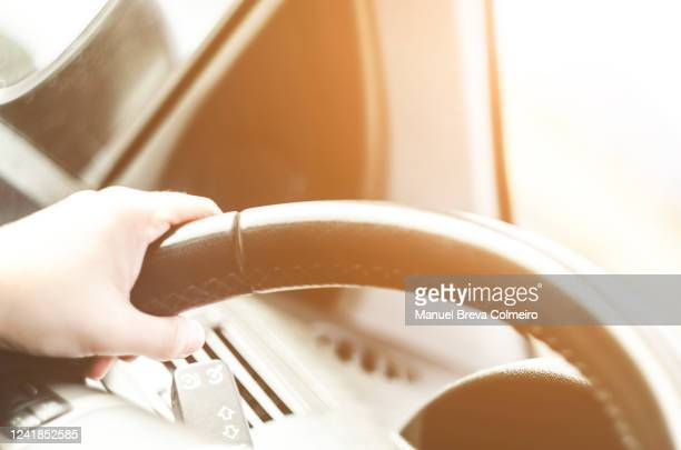 woman driving her car - green car crash stock pictures, royalty-free photos & images