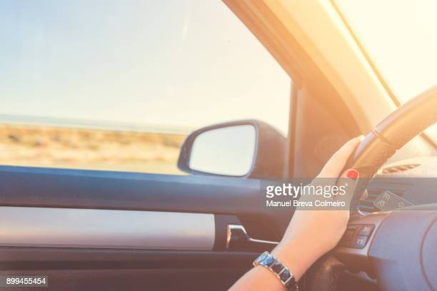 woman driving her car - green car crash stock photos and pictures