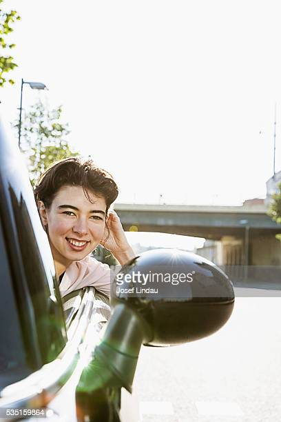 Woman driving open-top car