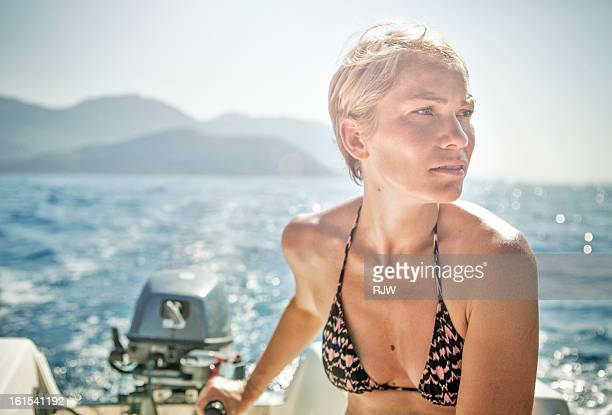 Woman driving speed boat