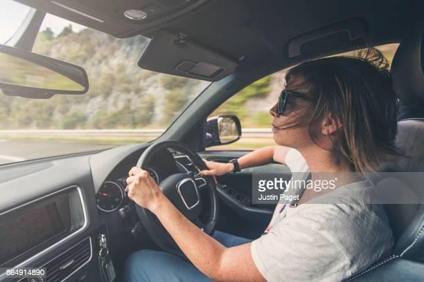 Woman driving SUV