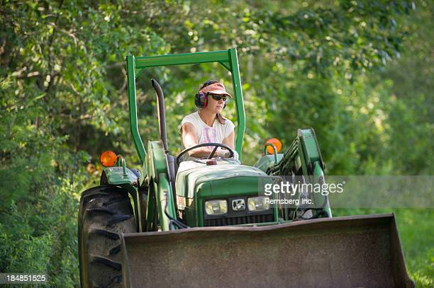 CONTENT] Woman driving tractor wearing ear and eye protection Lisbon Falls ME