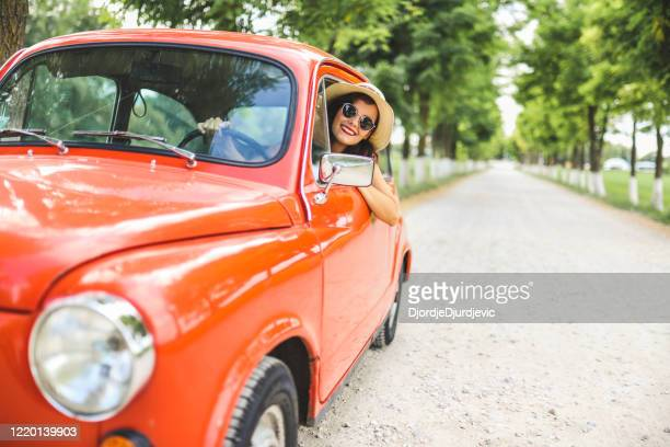 woman driving vintage car - old car stock pictures, royalty-free photos & images