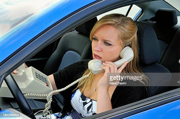Woman Driving While Talking on Landline-Style Phone
