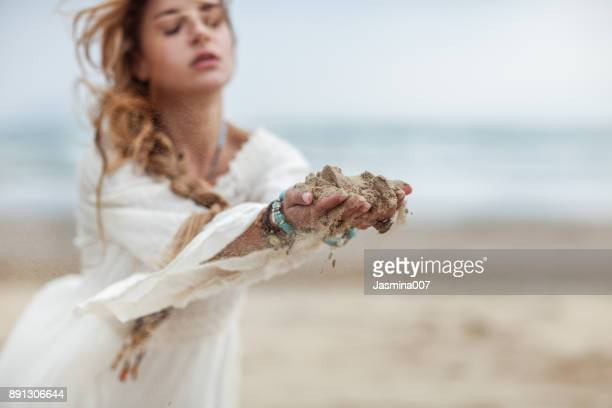 Woman dropping sand from hands
