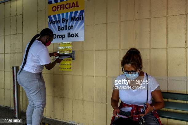 Woman drops her ballot by mail at Broward County Supervisor Of Elections Office in Lauderhill, Florida on October 5, 2020.