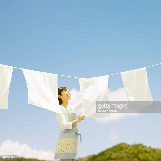 Woman Drying Clothes
