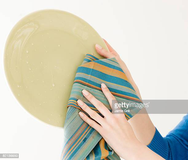 Woman drying dish