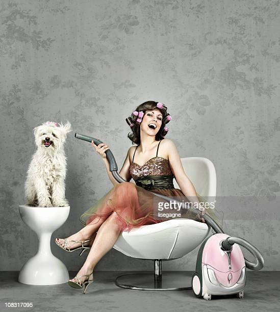 Woman drying dog fur with vacuum