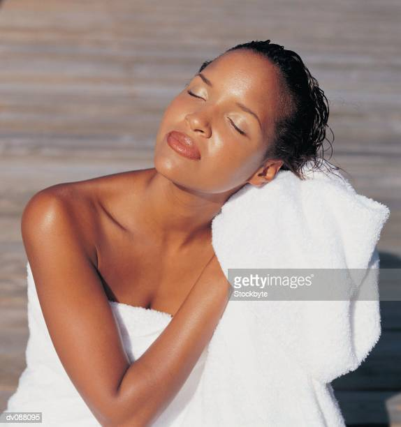 woman drying hair - washing hair stock pictures, royalty-free photos & images