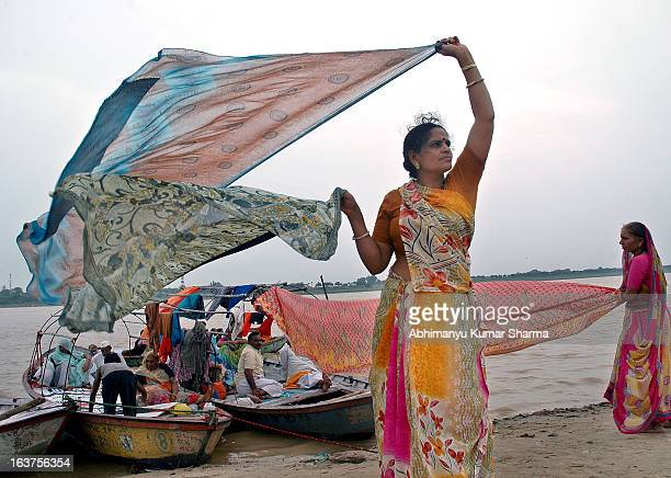 Woman drying her cloths after taking holy dip in Sangam on the occasion of very first Monday of sarawan month in Allahabad India, 21 July, 08. Photo...
