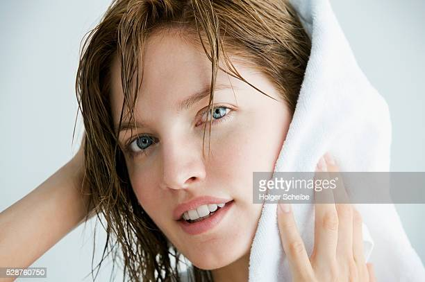 woman drying her hair with a towel - タオル ストックフォトと画像