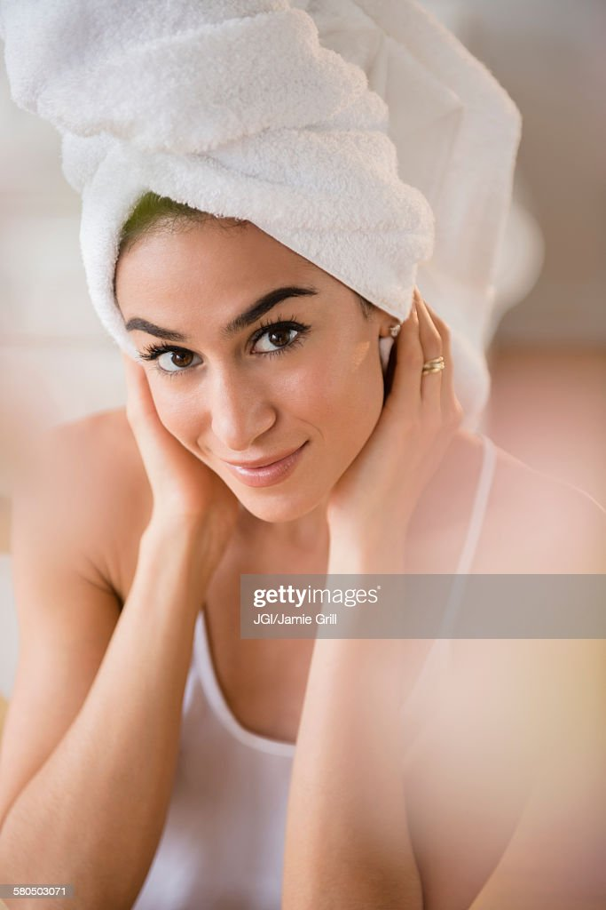 Woman drying her hair with towel : Stock Photo