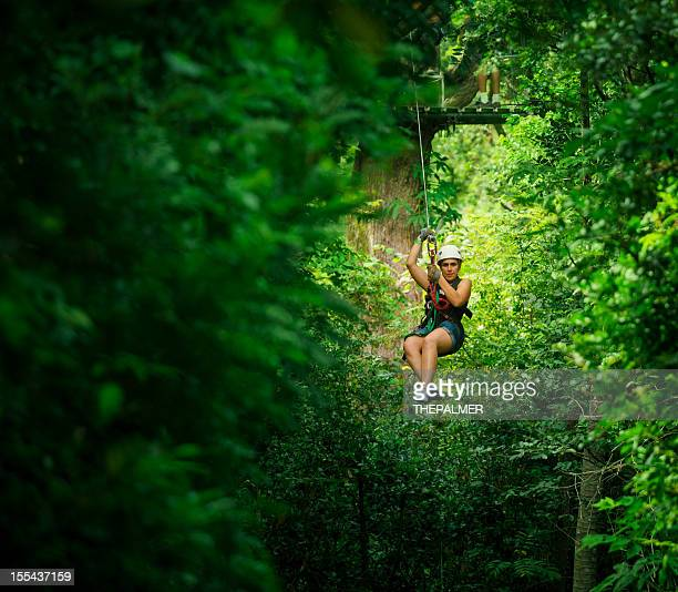 woman during a canopy tour in costa rica - costa rica stock photos and pictures