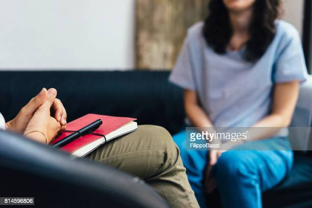 woman during a psychotherapy session - psychotherapy stock pictures, royalty-free photos & images