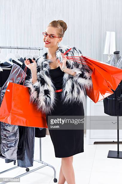woman during shopping - fur jacket stock pictures, royalty-free photos & images