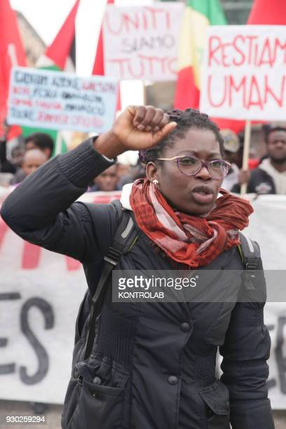 A woman during the demonstration that took place in Naples against racism and for Idy Diene a Senegalese street vendor killed in Florence