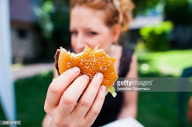 Woman eating a burger