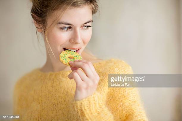 Woman eating a cookie