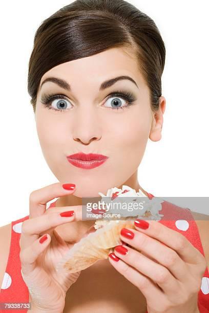 Woman eating a cream cake