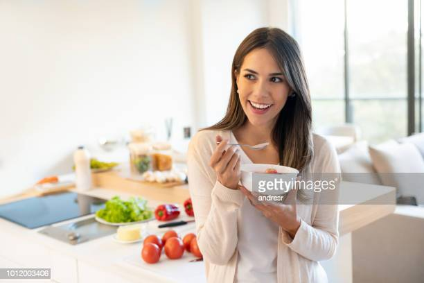 woman eating a healthy breakfast - healthy eating stock pictures, royalty-free photos & images