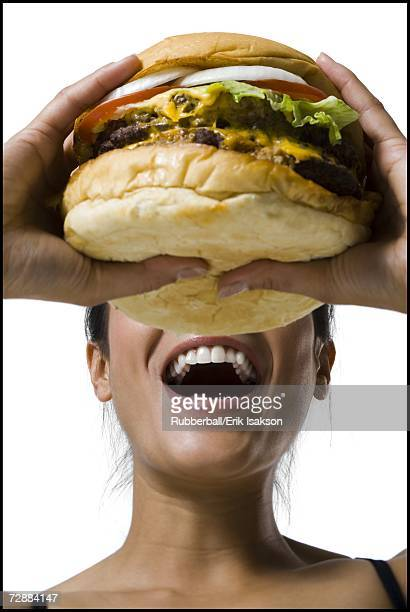 Woman eating a supersized hamburger