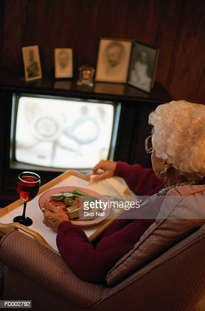 Woman Eating and Watching Television