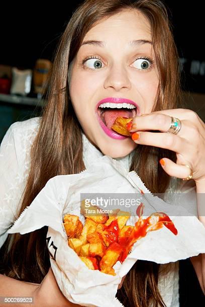 woman eating bag of ships