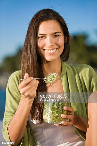 Woman eating bean sprouts