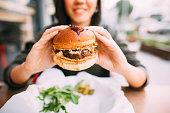 Woman eating beef burger