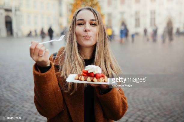 woman eating belgium waffles - capital region stock pictures, royalty-free photos & images