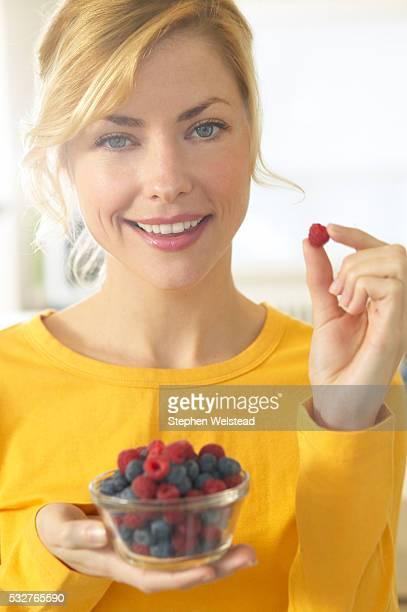 Woman Eating Bowl of Berries
