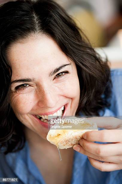 Woman Eating Bread With Honey