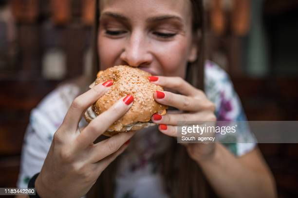 woman  eating  burger - biting stock pictures, royalty-free photos & images