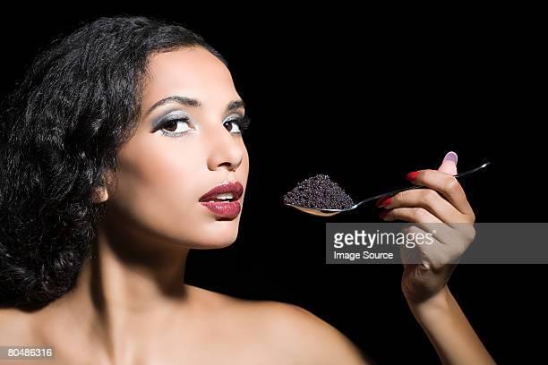 Woman eating caviar