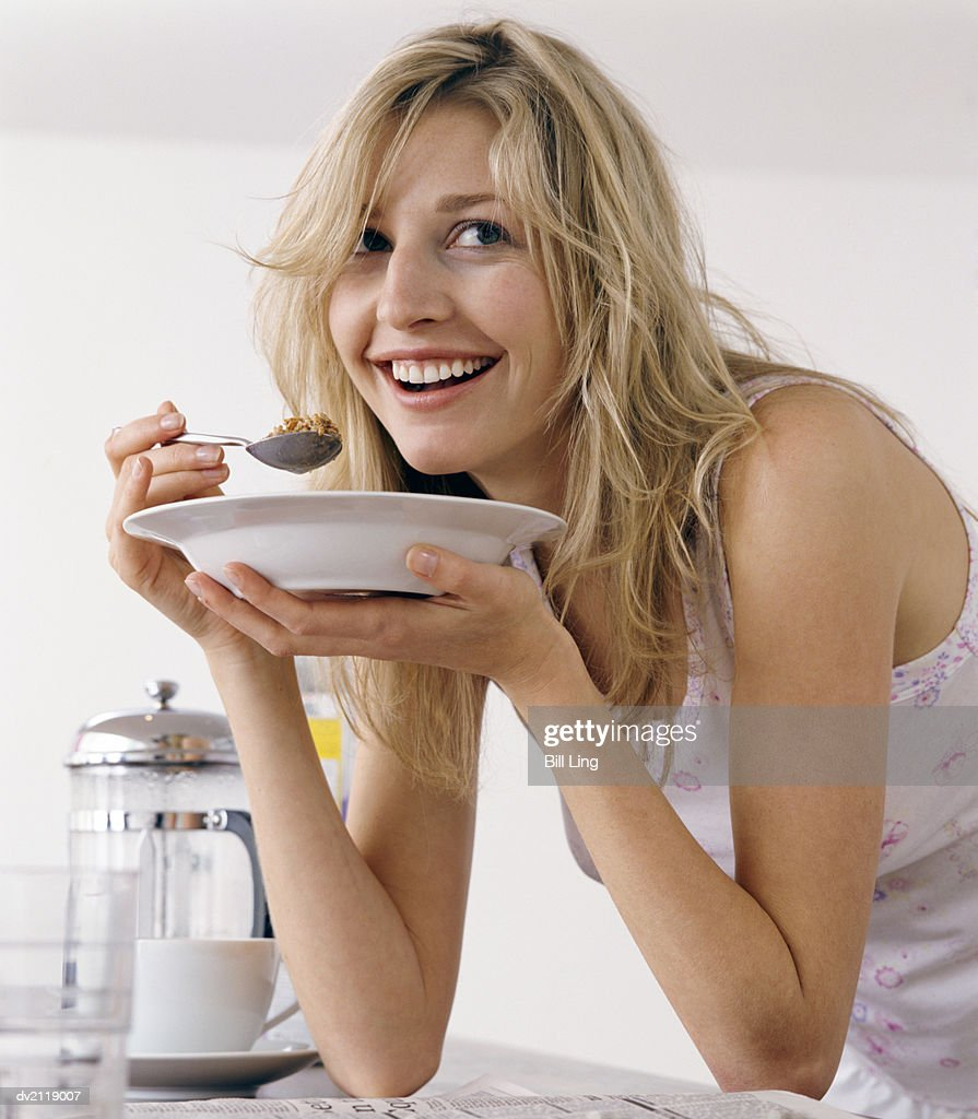 Woman Eating Cereals From a Plate : Stock Photo