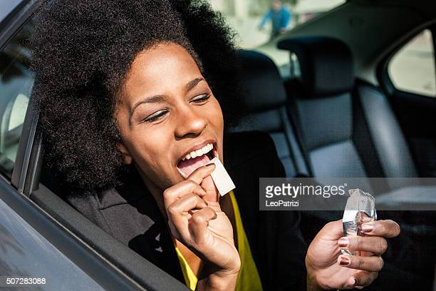 Woman eating chewing gum on a road trip