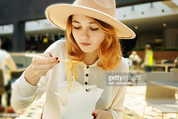 Woman eating Chinese take out food