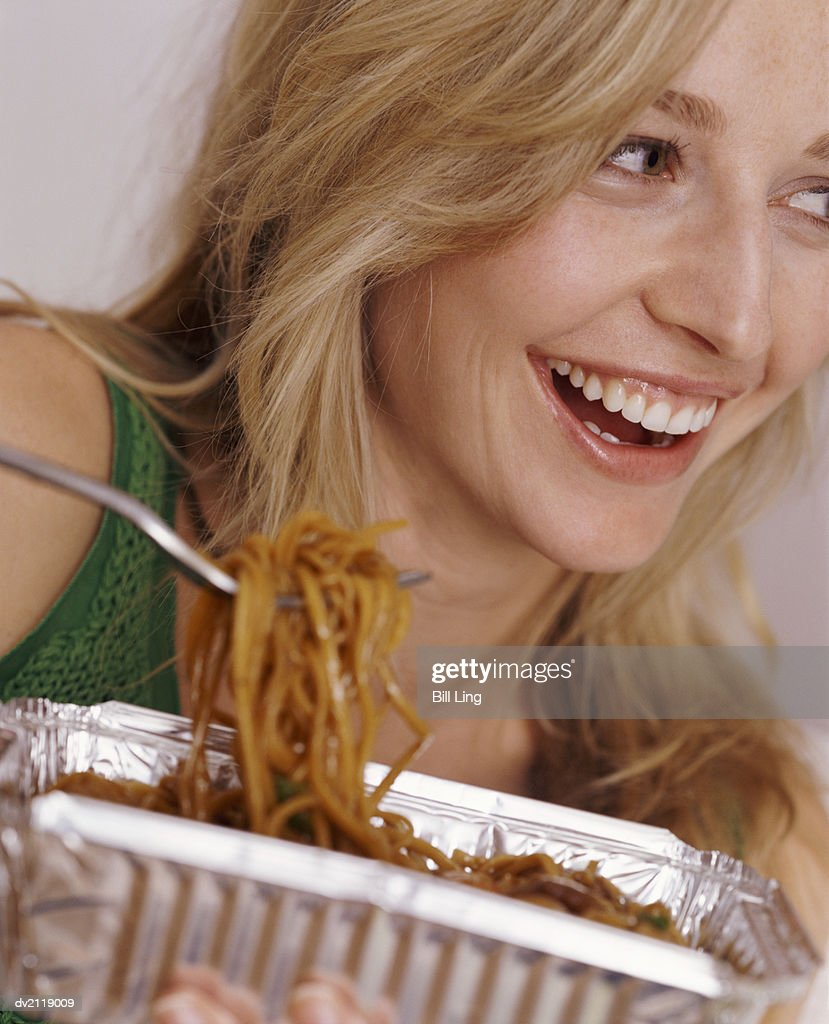 Woman Eating Chinese Take-Away Food : Stock Photo