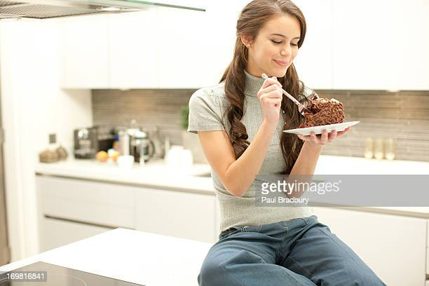 Woman eating chocolate cake