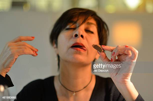 woman eating chocolate with ecstatic expression - depczyk stock pictures, royalty-free photos & images