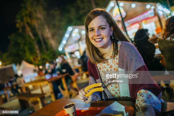 woman eating churros - churro stock photos and pictures