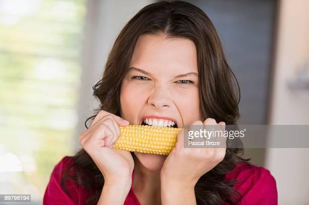 Woman eating corn on the cob