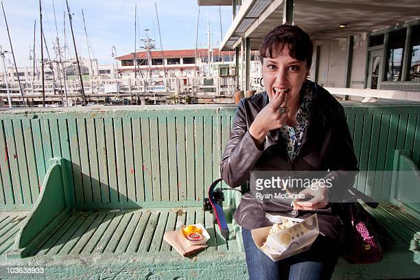 woman eating crab - fishermans wharf stock pictures, royalty-free photos & images