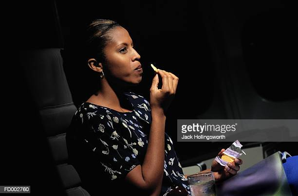 Woman Eating Crackers